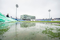 Picture by Allan McKenzie/SWpix.com - 13/04/2018 - Cricket - Specsavers County Championship - Yorkshire County Cricket Club v Essex County Cricket Club - Emerald Headingley Stadium, Leeds, England - Water pours off the covers at Headingley on the first day of the Specsaver's County Championship.