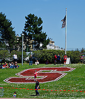 SAN FRANCISCO, CA - April 14, 2012: Little Stanford fan during the National Anthem at the Stanford Cardinal and White Spring Game at Kezar Stadium in San Francisco, CA.