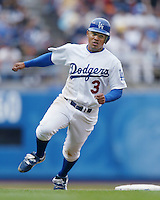 Cesar Izturis of the Los Angeles Dodgers runs the bases during a 2002 MLB season game at Dodger Stadium, in Los Angeles, California. (Larry Goren/Four Seam Images)