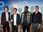(L-R) British singer and co-producer Mick Jagger, US film producer Brian Grazer, US actor Chadwick Boseman and US film director Tate Taylor attend the 'Get On Up' photocall during the 40th Deauville American Film Festival on September 12, 2014 in Deauville, France.