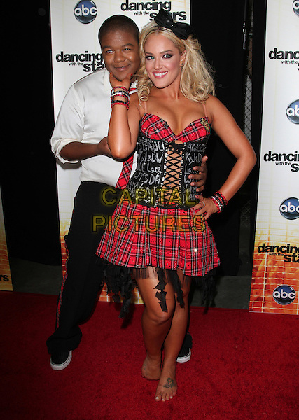 "KYLE MASSEY & LACEY SCHWIMMER.""Dancing With The Stars"" Season Premiere held at CBS Studios, Los Angeles, CA, USA..September 20th, 2010.full length black trousers white shirt red plaid tartan tie dress skirt hand on hip posing gesture corset chin.CAP/ADM/KB.©Kevan Brooks/AdMedia/Capital Pictures."