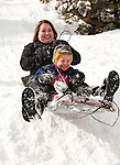 California, Lake Tahoe: Child and mother enjoy snow play with sled at North Lake Tahoe Regional Park.  Photo copyright Lee Foster.  Photo # cataho107687