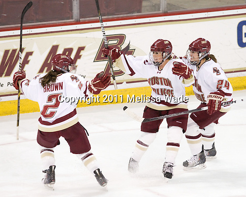 Kristina Brown (BC - 2), Caitlin Walsh (BC - 11) and Meagan Mangene (BC - 24) celebrate Walsh's goal. - The Boston College Eagles defeated the Harvard University Crimson 3-1 to win the 2011 Beanpot championship on Tuesday, February 15, 2011, at Conte Forum in Chestnut Hill, Massachusetts.