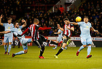 Leon Clarke of Sheffield Utd and Enda Stevens of Sheffield Utd  go for the same volley during the Championship match at Bramall Lane Stadium, Sheffield. Picture date 26th December 2017. Picture credit should read: Simon Bellis/Sportimage
