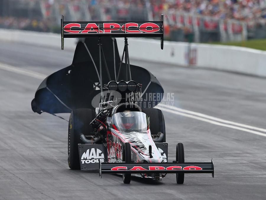 Jun 20, 2015; Bristol, TN, USA; NHRA top fuel driver Steve Torrence during qualifying for the Thunder Valley Nationals at Bristol Dragway. Mandatory Credit: Mark J. Rebilas-