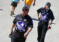 Apr 25, 2015; Baytown, TX, USA; Jimmy Prock (left) and John Medlen , co crew chiefs for NHRA funny car driver Jack Beckman (not pictured) during qualifying for the Spring Nationals at Royal Purple Raceway. Mandatory Credit: Mark J. Rebilas-