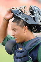 Catcher Roberto Pena (10) of the Lexington Legends, Class A affiliate of the Houston Astros, prior to a game against the Greenville Drive on August 5, 2011, at Fluor Field at the West End in Greenville, South Carolina. (Tom Priddy/Four Seam Images)