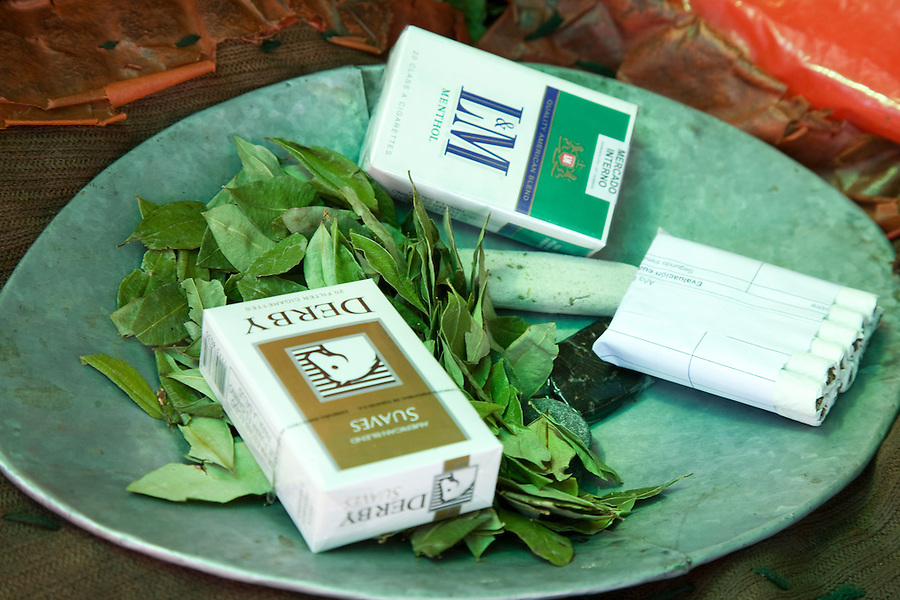 Coca leaves and llicta (an alkaline substance mixed with coca leaves in the mouth to activate alkaloids) for sale in the miner's barrio of Potosí.