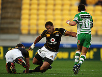 Manawatu first five Aaron Cruden steps inside Shaun Treeby and Masefau Lauluniu. Air NZ Cup - Wellington Lions v Manawatu Turbos at Westpac Stadium, Wellington, New Zealand. Saturday 3 October 2009. Photo: Dave Lintott / lintottphoto.co.nz