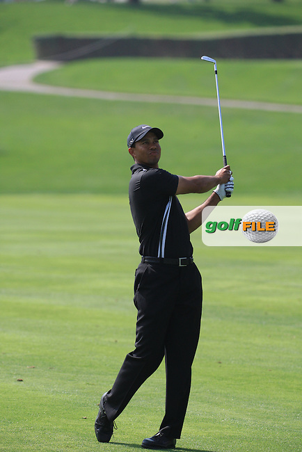 Tiger Woods (USA) playing his second shot on the first .on day one of the Omega Dubai Desert Classic 2011 on the Majlis Course, Emirates Golf Club, Dubai, UAE. 10/02/2011.Picture Fran Caffrey/www.golffile.ie.