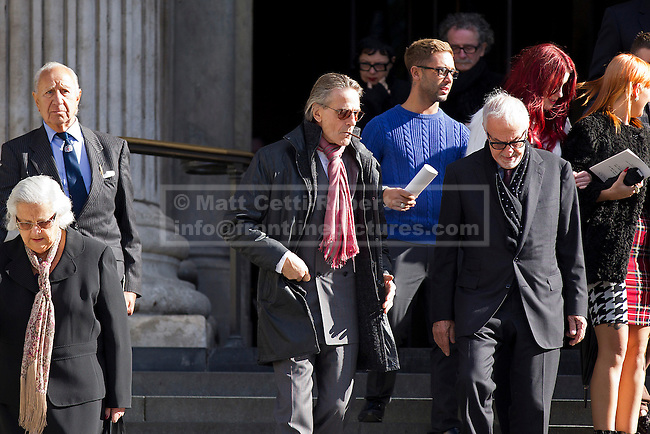 12/10/2012. LONDON, UK. Actor Jeremy Irons (Centre with pink scarf) is seen leaving St Paul's Cathedral after a memorial service for hairdresser Vidal Sassoon in London today (12/10/12) . Photo credit: Matt Cetti-Roberts