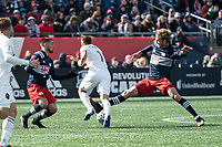 FOXBOROUGH, MA - MARCH 7: Henry Kessler #4 of New England Revolution tackles Przemyslaw Frankowski #11 of Chicago Fire with Diego Fagundez #14 of New England Revolution in support.  The tackle resulted in a yellow card during a game between Chicago Fire and New England Revolution at Gillette Stadium on March 7, 2020 in Foxborough, Massachusetts.