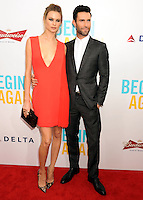 "NEW YORK CITY, NY, USA - JUNE 25: Model Behati Prinsloo and Musician Adam Levine arrive at the New York Premiere Of The Weinstein Company's ""Begin Again"" held at the SVA Theatre on June 25, 2014 in New York City, New York, United States. (Photo by Celebrity Monitor)"