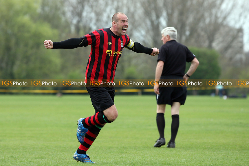 Chapel N1 (red and black shirts) vs Walthamstow Village (blue and white shirts)- Jack Morgan Cup Final at Hackney Marshes 28/04/13 - MANDATORY CREDIT: Dave Simpson/TGSPHOTO - Self billing applies where appropriate - 0845 094 6026 - contact@tgsphoto.co.uk - NO UNPAID USE