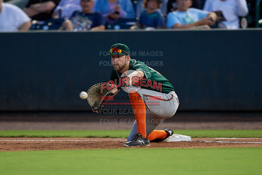 Greensboro Grasshoppers first baseman Luke Mangieri (12) stretches for a throw during a South Atlantic League game against the Delmarva Shorebirds on August 21, 2019 at Arthur W. Perdue Stadium in Salisbury, Maryland.  Delmarva defeated Greensboro 1-0.  (Mike Janes/Four Seam Images)