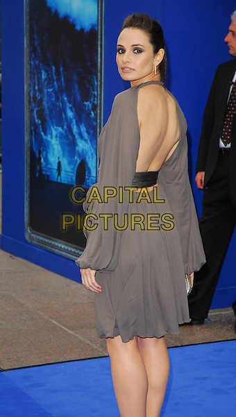 "MIA MAESTRO.At the UK Film Premiere of ""Poseidon"", .Empire Leicester Square, London, .May 28th 2006..half length grey dress wrap waist sash looking back over shoulder behind rear.Ref: CAN.www.capitalpictures.com.sales@capitalpictures.com.©Can Nguyen/Capital Pictures"