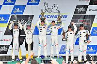 #25 BMW Team RLL BMW M8, GTLM: Alexander Sims, Connor de Phillippi, #3 Corvette Racing Chevrolet Corvette C7.R, GTLM: Antonio Garcia, Jan Magnussen, #24 BMW Team RLL BMW M8 GTLM: John Edwards, Jesse Krohn celebrate the win on the podium