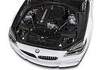 Car Stock 2016 BMW 6 Series 640i Gran Coupe 4 Door Sedan Engine  high angle detail view