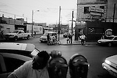Juarez, Mexico.May 19, 2008<br /> <br /> Life along the US/ Mexican - El Paso/Juarez border from the Mexican side. A street just near the border full of prostitutes and hooker night clubs.