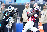 CHARLOTTE, NC - NOVEMBER 17: Calvin Ridley #18 of the Atlanta Falcons catches a pass over Donte Jackson #26 of the Carolina Panthers during a game between Atlanta Falcons and Carolina Panthers at Bank of America Stadium on November 17, 2019 in Charlotte, North Carolina.