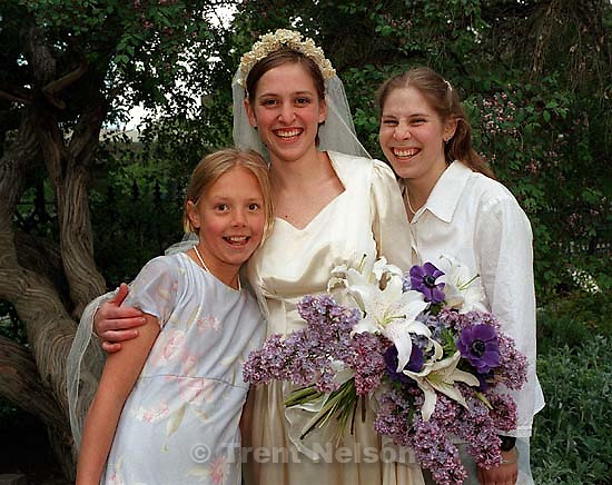 Rebecca Clark, Casey Clark, Tessa Clark at Casey and John's wedding.<br />