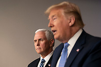 United States Vice President Mike Pence listens as US President Donald J. Trump makes a statement on coronavirus during a news briefing at the White House in Washington, DC on March 15, 2020. <br /> Credit: Chris Kleponis / Pool via CNP/AdMedia