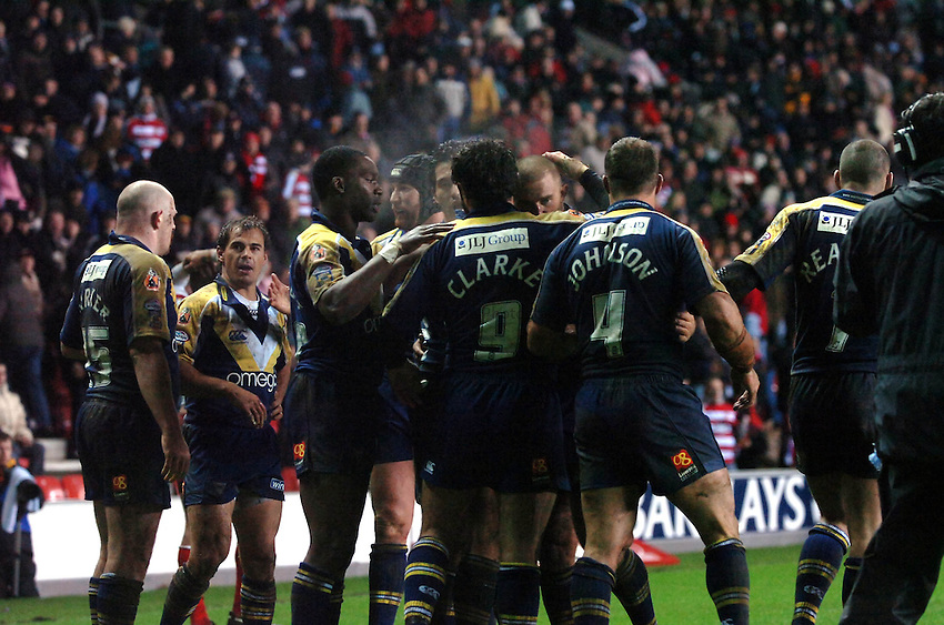 Photo: Paul Greenwood..Wigan Warriors v Warrington Wolves. Engage Super League 2007. 09/02/2007. The Warrington players celebrate victory at the final hooter.