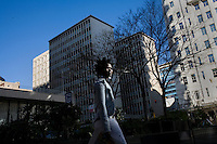 JOHANNESBURG, SOUTH AFRICA - JULY 20:  A woman walks in downtown Johannesburg, South Africa.  (Photo by Landon Nordeman)