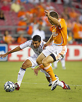 Real Salt Lake midfielder Javier Morales (10) takes the ball from Houston Dynamo midfielder Brian Mullan (9). The Houston Dynamo defeated Real Salt Lake 4-3 during an MLS regular season game at Robertson Stadium in Houston, TX on September 8, 2007.