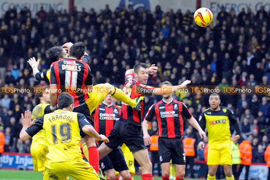 Gabriele Angella of Watford beats Charlie Daniels of AFC Bournemouth to a header to score - AFC Bournemouth vs Watford - Sky Bet Championship Football at the Goldsands Stadium, Bournemouth, Dorset - 18/01/14 - MANDATORY CREDIT: Denis Murphy/TGSPHOTO - Self billing applies where appropriate - 0845 094 6026 - contact@tgsphoto.co.uk - NO UNPAID USE