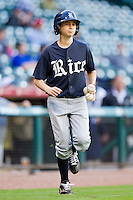 The Rice Owls batboy brings three baseballs to the home plate umpire during the game against the Baylor Bears at Minute Maid Park on March 6, 2011 in Houston, Texas.  Photo by Brian Westerholt / Four Seam Images