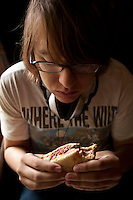 19 year-old Miles Bowe eats a hamburger at Louis' Lunch in New Haven, CT, USA, 26 May 2009.
