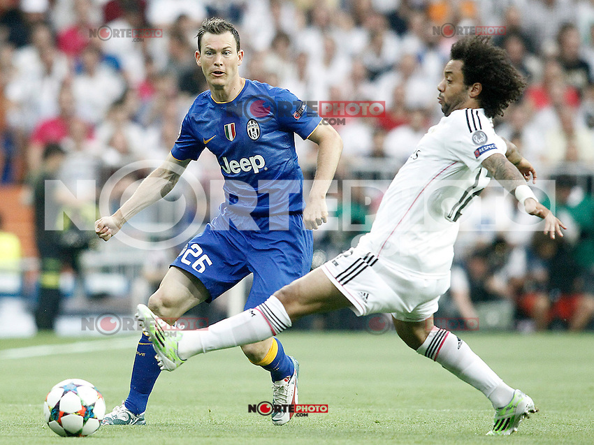 Real Madrid's Marcelo Vieira (r) and Juventus' Stephan Lichtsteiner during Champions League 2014/2015 Semi-finals 2nd leg match.May 13,2015. (ALTERPHOTOS/Acero) /NortePhoto.COM