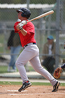 March 18, 2010:  Third Baseman David Renfroe of the Boston Red Sox organization hits a home run to right field during Spring Training at Ft.  Myers Training Complex in Fort Myers, FL.  Photo By Mike Janes/Four Seam Images