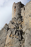 "Tour de la Dame Blanche or White Lady Tower, Puilaurens Castle, Chateau de Puilaurens, Cathar castle, Lapradelle-Puilaurens, Boulzane Valley, Aude, France.  Also called Puylaurens, or lo Castel de Pueg-Laurenc in Occitan, this 12th century ruined castle had belonged to the Abbey of Saint-Michel de Cuxa before being acquired by the Queen of Aragon in 1162. It changed hands many times during the Albigensian Crusade. It is one of the ""Five Sons of Carcassonne"" or ""cinq fils de Carcassonne"" and is a listed monument historique. Picture by Manuel Cohen"