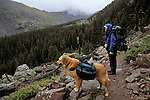 Backpacker and dog on the Venable-Comanche trail, Sangre de Cristo Wilderness, San Isabel National Forest, Colorado
