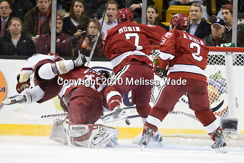 Joe Whitney (BC - 15), Kyle Richter (Harvard - 33), Chad Morin (Harvard - 7), Alex Biega (Harvard - 3) - The Boston College Eagles defeated the Harvard University Crimson 6-0 on Monday, February 1, 2010, in the first round of the 2010 Beanpot at the TD Garden in Boston, Massachusetts.