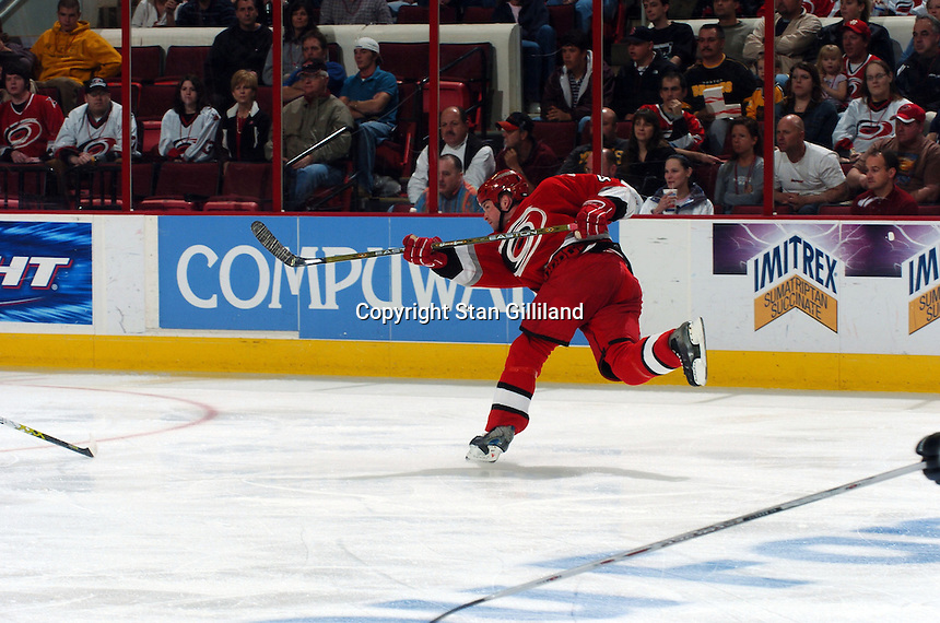 Carolina Hurricanes' Aaron Ward shoots to score his first of two goals against the Boston Bruins at the RBC Center in Raleigh, NC Wednesday, March 1, 2006. Ward also scored the game winner, as the Hurricanes won 4-3...
