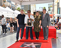 LOS ANGELES, CA. August 22, 2018: Rob Stringer, Simon Cowell, Kelly Clarkson & Leron Gubler at the Hollywood Walk of Fame Star Ceremony honoring Simon Cowell.