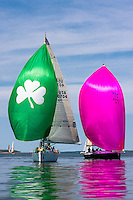 J.D. Hills, Second Star, a J/122, and Virginia Meade's Irish Rover, a Beneteau 40.7, flying spinnakers in calm waters at Texoma Sailing Club Lakefest Regatta 2011, 25th annual charity regatta at Lake Texoma, Denison, Texas.