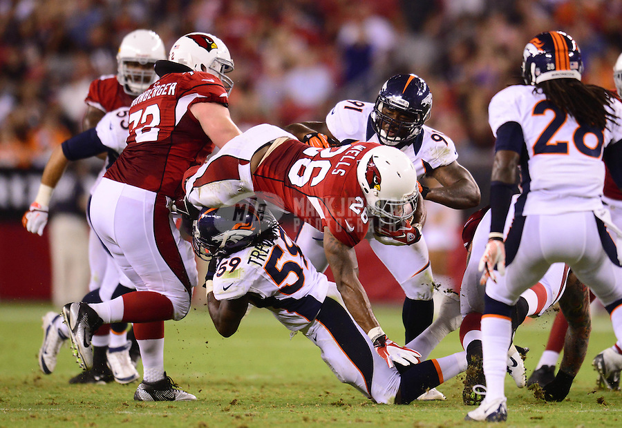 Aug. 30, 2012; Glendale, AZ, USA; Arizona Cardinals running back (26) Beanie Wells is upended by Denver Broncos linebacker (59) Danny Trevathan in the second quarter during a preseason game at University of Phoenix Stadium. Mandatory Credit: Mark J. Rebilas-