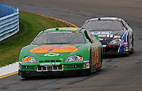 Aug. 8, 2009; Watkins Glen, NY, USA; NASCAR Nationwide Series driver Morgan Shepherd (89) leads Brendan Gaughan during the Zippo 200 at Watkins Glen International. Mandatory Credit: Mark J. Rebilas-