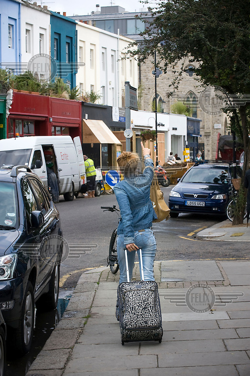 A woman on Westbourne Grove in Notting Hill, West London.