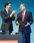 © Joel Goodman - 07973 332324 . 23/09/2013 . Brighton , UK . Ed Miliband applauds following Ed Balls ' , MP for Morley and Outwood and Shadow Chancellor of the Exchequer , address to the conference this afternoon (Monday 23rd September 2013) . Day 2 of the Labour Party 's annual conference in Brighton . Photo credit : Joel Goodman