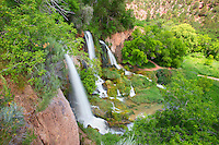 With a three-forked waterfall flowing over the cliff, the color green stretched as far as you could see at Rifle Falls State Park near Rifle, Colorado. This 70-foot waterfall is the centerpiece of this small park and offers a trail that takes you to the top of the falls for a bird's-eye view.