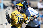 06 February 2016: Michigan's Ian King (10) and North Carolina's Zach Powers (behind). The University of North Carolina Tar Heels hosted the University of Michigan Wolverines in a 2016 NCAA Division I Men's Lacrosse match. UNC won the game 20-10.