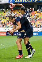 USWNT midfielder (16) Angela Hucles  celebrates with teammate Carli Lloyd after the finals of the Peace Queen Cup.  The USWNT defeated Canada, 1-0, at Suwon World Cup Stadium in Suwon, South Korea.