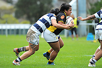 Ayesha Leti-I'iga is tackled during the Farah Palmer Cup women's provincial rugby match between Wellington Pride  and Auckland at Jerry Collins Stadium / Porirua Park, Wellington, New Zealand on Saturday, 23 September 2017. Photo: Dave Lintott / lintottphoto.co.nz