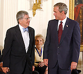 "United States President George W. Bush, right, honors former New York Times executive editor and columnist and New York Daily News columnist Abraham Michael ""A.M."" Rosenthal, left, with the Presidential Medal of Freedom during a ceremony in the East Room of the White House in Washington, DC on 9 July, 2002.  Former first lady Nancy Reagan looks on from center.<br /> Credit: Ron Sachs / CNP"