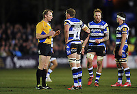 Referee Wayne Barnes, officiating his 150th Premiership match, speaks to Bath Rugby captain Stuart Hooper. Aviva Premiership match, between Bath Rugby and Sale Sharks on March 6, 2015 at the Recreation Ground in Bath, England. Photo by: Patrick Khachfe / Onside Images